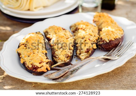 Meat and Tomato Stuffed Eggplant Halves with Cheese Crust, selective focus on the middle eggplant crust