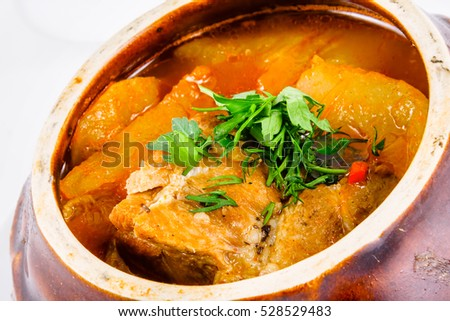 Meat stewed in a pot with potatoes
