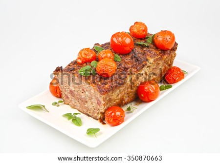 meatloaf with cherry tomatoes isolated on white