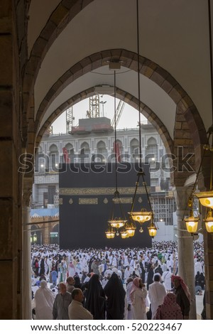MECCA-JUNE 2013 : Muslim pilgrims circumambulate the Kaaba from ground floor of Haram Mosque in Makkah Saudi Arabia. Muslims all around the world face the Kaaba during prayer time.