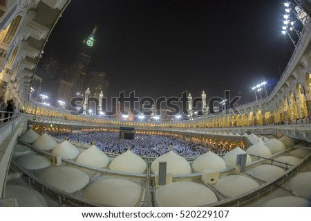 MECCA, S.ARABIA-. FEB 2012: Fisheye view of Kaabah and Abraj Al Bait (Royal Clock Tower Makkah) in Makkah. The tower is the tallest clock tower in the world at 601m, built at a cost of USD1.5 billion