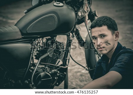 Mechanic with motorcycle .Vintage style.