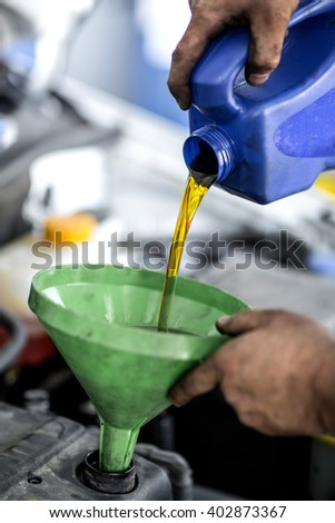 Mechanical hand man performing an oil change