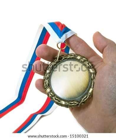 medal in hand isolated over white
