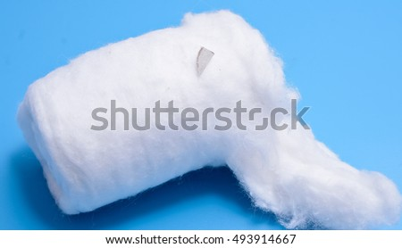 medical cotton wool on a blue background