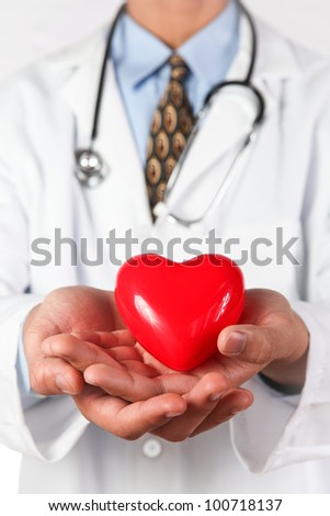 Medical Doctor with red heart in hand.