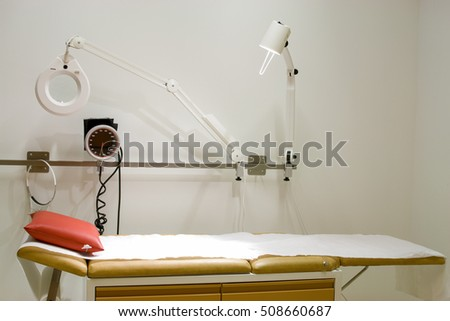 Medical examination table at doctor's office