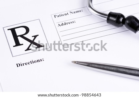 Medical prescription with a pen and a stethoscope on top of it