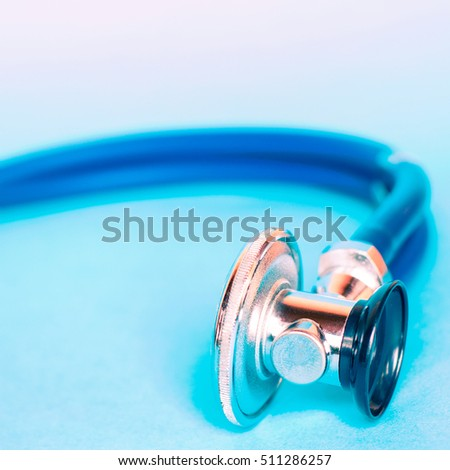 Medical stethoscope on blue background. Medicine, health hospital equipment for health care, treatment. Closeup diagnostic instrument, examination device for pulse, heartbeat.Cardiology test.
