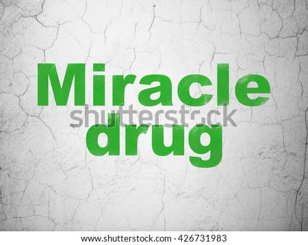Medicine concept: Green Miracle Drug on textured concrete wall background