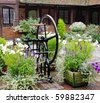 Medieval Cobbled English Courtyard Garden with Well in the center - stock photo