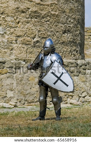 Medieval european knight near citadel wall