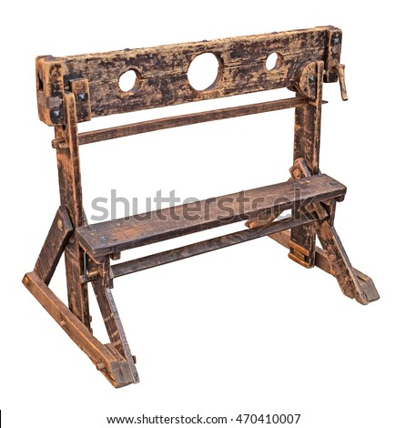 medieval pillory, ancient device used for punishment by public humiliation and physical abuse - old wooden stocks isolated with clipping path