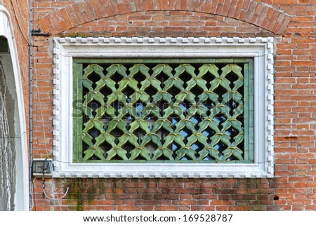 Medieval window with ceramic in Venice