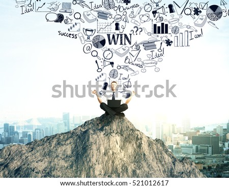 Meditating businessman on mountain top with creative business sketch. Leadership concept