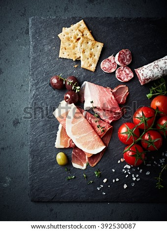Mediterranean antipasto on a black slate