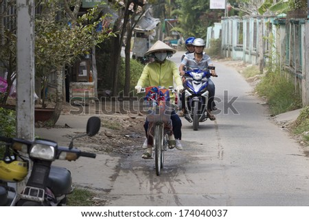 MEKONG DELTA, VIETNAM - DEC 29:Unidentified people riding bicyclein An Giang, Vietnam on Dec 29, 2013. An Giang occupies a position in the upper reaches of the Mekong Delta.