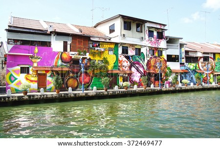 MELAKA, MALAYSIA -JANUARY 29,2014: Street art on buildings along the Melaka river. Malacca, dubbed Historic State historical city centre has been listed as UNESCO World Heritage Site since 7 /8/ 2008.
