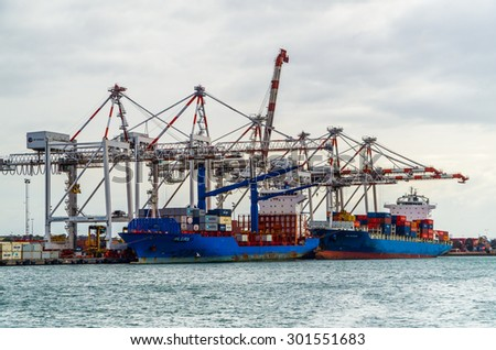 Melbourne, Australia - July 25, 2015: container ships ANL Barwon (front) and ANL Euroa (rear) being unloaded at Swanston Dock in the Port of Melbourne, Australia's busiest container port.