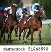 MELBOURNE - FEBRUARY 21: Horses in the finishing straight in the Ritchies Communities Benefits Plate, won by Quantum Fire at Yarra Glen on February 21, 2010 near Melbourne, Australia. - stock photo