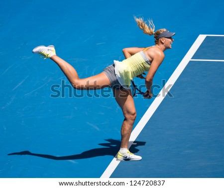 MELBOURNE - JANUARY 14: Maria Sharapova of Russia in her first round win over Olga Puchkova or Russia at the 2013 Australian Open on January 14, 2013 in Melbourne, Australia.