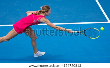 MELBOURNE - JANUARY 14: Sesil Karatantcheva in her first round loss to Li Na of China at the 2013 Australian Open on January 14, 2013 in Melbourne, Australia.