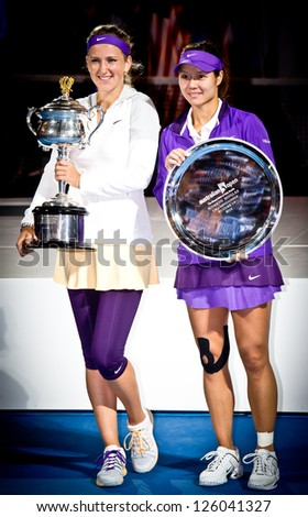 MELBOURNE - JANUARY 26: Victoria Azarenka (L) of Belarus with runner-up Li Na of China and the trophy for winning the 2013 Australian Open on January26, 2013 in Melbourne, Australia.