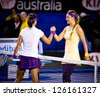 MELBOURNE - JANUARY 26: Victoria Azarenka (R) of Belarus after beating Li Na (L)of Chins to win the 2013 Australian Open on January26, 2013 in Melbourne, Australia. - stock photo
