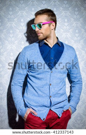 Men's beauty, fashion. Elegant good looking young man.