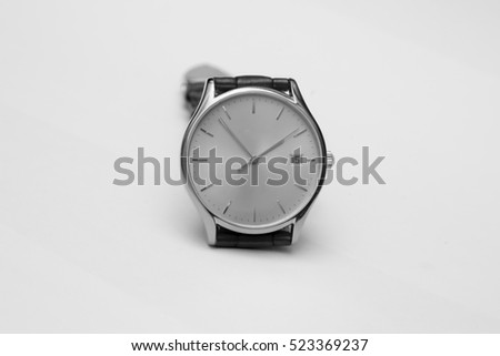 Men's gold watch with leather strap isolated on white background. Black and White.