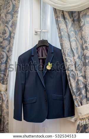 Men's suit and wedding bouquet of flowers