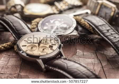 men watches on wooden table