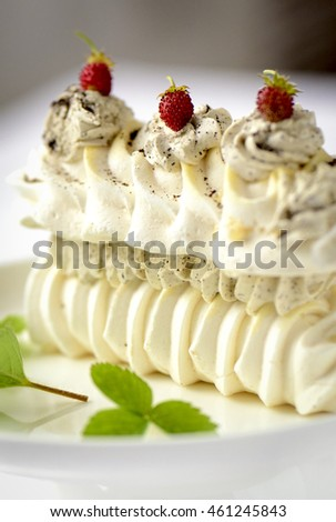 meringue cake with fresh berries on white background
