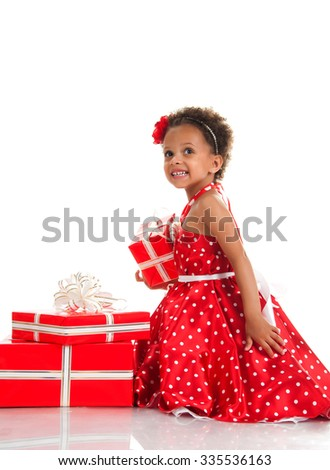 Merry mulatto girl with curly hair and red gift boxes. Shopping, presents, holiday, congratulations