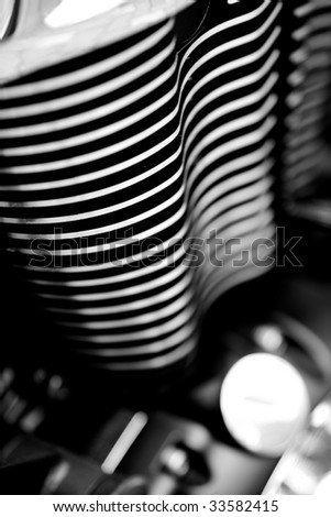 Metal cooling fins of a motorcycle engine abstract