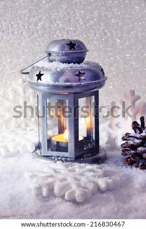 Metal flash light and Christmas decoration on light background