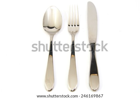 Metal fork, spoon and knife on white background