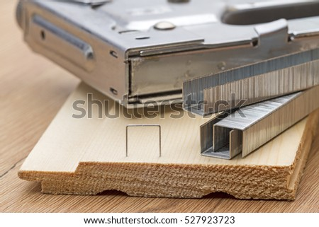 Metal staples for staple gun on the board