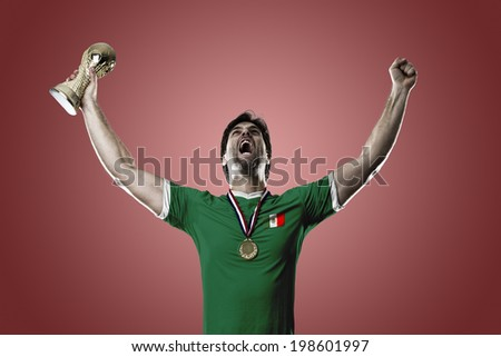 Mexican soccer player, celebrating the championship with a trophy in his hand. On a red background.