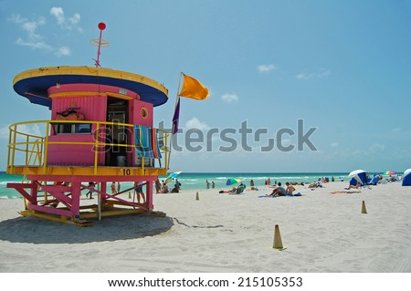MIAMI - August 24: view of Miami Beach with a pink art deco lifeguard tower in Miami, Florida on August 24, 2011. Twenty nine towers line the beach and are iconic images of Miami Beach.