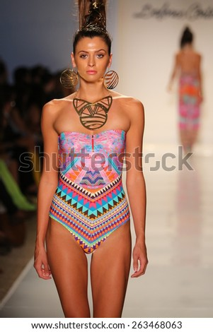 MIAMI, FL - JULY 18: A model walks the runway at the Dolores Cortes fashion show during MBFW Swim 2015 at The Raleigh hotel on July 18, 2014 in Miami, FL.
