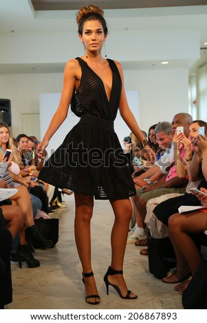 MIAMI - JULY 19: Model walks runway for Caitlin Kelly Swimwear during MBFW Miami Swim on July 19, 2014 in Miami Beach Florida