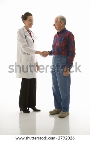 Mid-adult Caucasian female doctor shaking hands with an elderly Caucasian male.