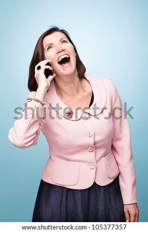 middle age woman laughing smiling on mobile phone