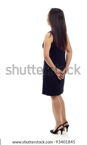 Middle aged Asian business woman from the back - looking at something over a white background