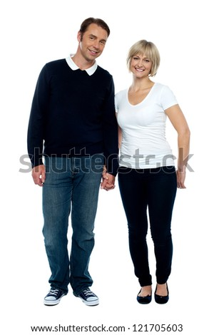 Middle aged couple posing with hand in hand, strong bonding and love.
