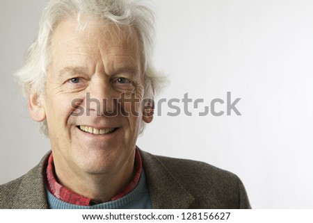 Middle aged man on a white background looking at the camera