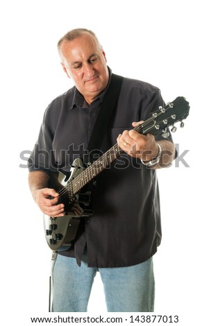 Middle-aged man playing black electric guitar. Shot on white background.