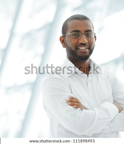 Middle Eastern Arabic black man at office building