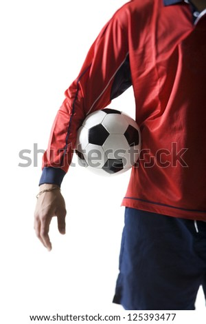 Midsection of a soccer player holding a ball